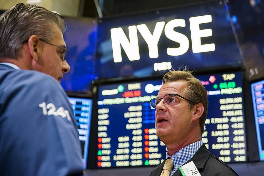 Traders work on the floor of the New York Stock Exchange in New York on Sept 1, 2015.