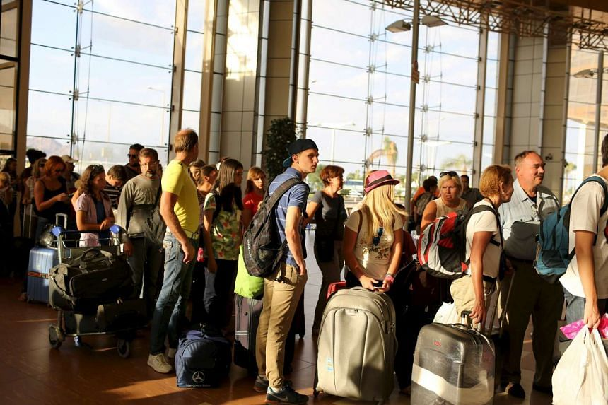 British and Russian passengers queue to leave the airport of the Red Sea resort of Sharm el-Sheikh.