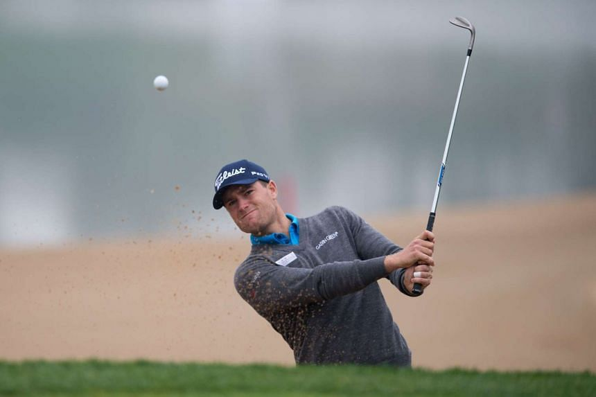 Lucas Bjerregaard of Denmark plays shot out of the bunker during the BMW Shanghai Masters golf tournament at the Lake Malaren Golf Club in Shanghai.