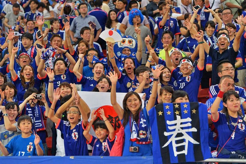 Japan fans celebrates in the match between Singapore and Japan.