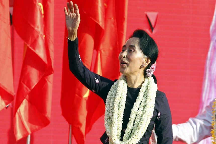 Aung San Suu Kyi, chairperson of National League for Democracy (NLD) party, greeting to her supporters during her election campaign rally in Yangon.