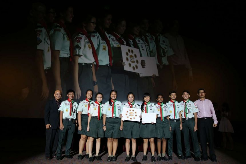 Students from Gan Eng Seng School receiving their award at the ceremony.