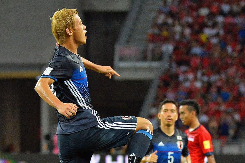 Japanese ace Keisuke Honda celebrating his goal against Singapore in their Asian Group E World Cup qualifier last night. The AC Milan striker's goal was one of three Japan scored in their 3-0 win before 33,868 spectators at the National Stadium. Japa