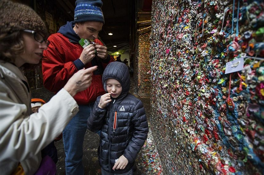Mrs Christie Fergus, with her husband Brian and son Michael, visiting from Phoenix to contribute to the gum wall. In the days before the big clean-up, there was a rush of last-minute visits and gum-themed selfies.