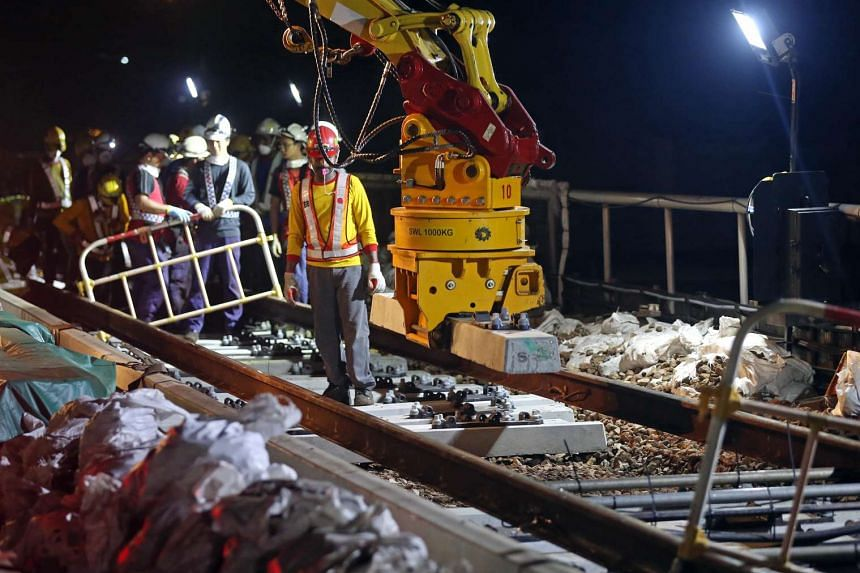 A Road Rail Vehicle is used to place new concrete sleepers.