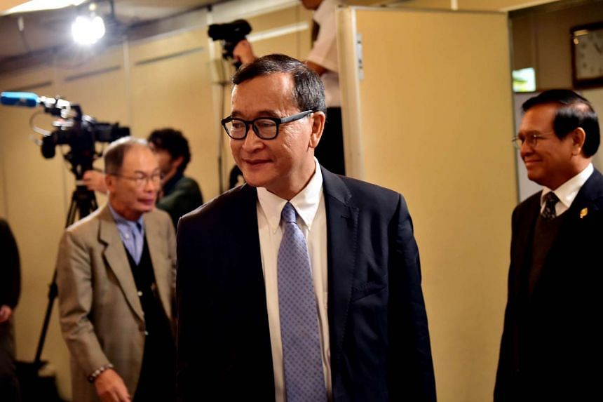 Cambodia's main opposition Cambodia National Rescue Party president Sam Rainsy arrives at a conference room.
