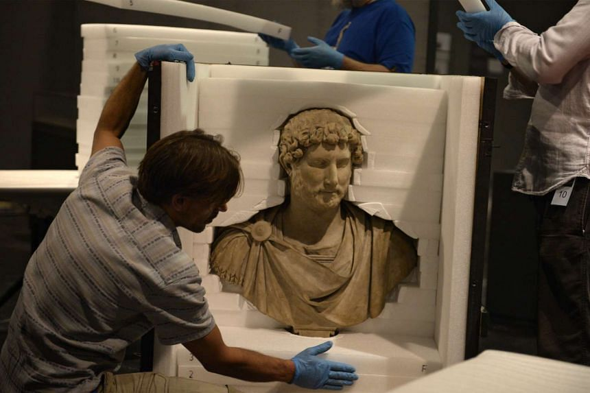 A bust of Emperor Hadrian from Tivoli, Italy, dating back to around AD125-130, is unveiled to the media at the National Museum of Singapore on Nov 13, 2015.