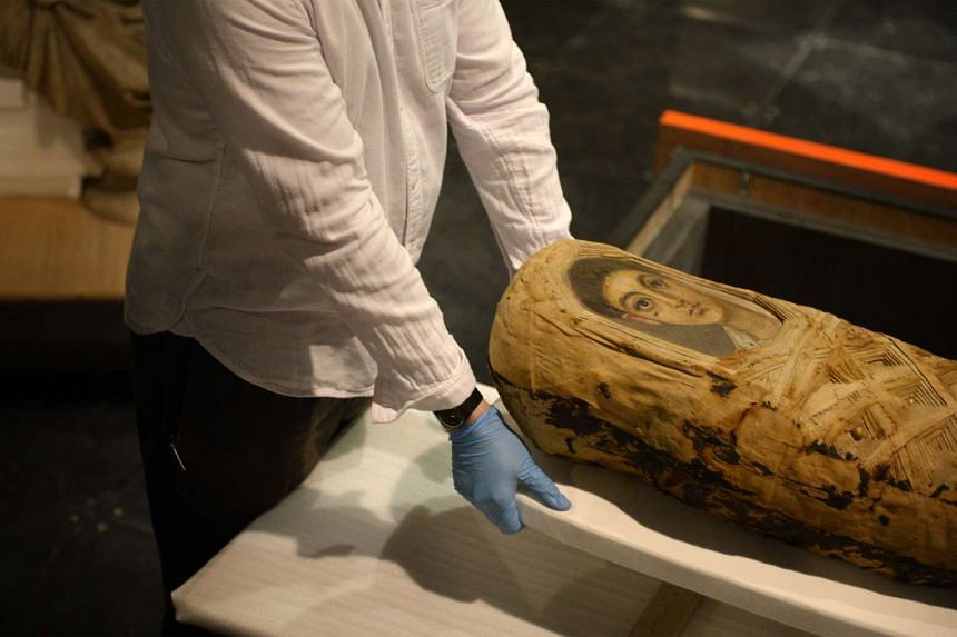 The mummy of an adolescent boy from Hawara, Egypt is unveiled to the media at the National Museum of Singapore on Nov 13, 2015.