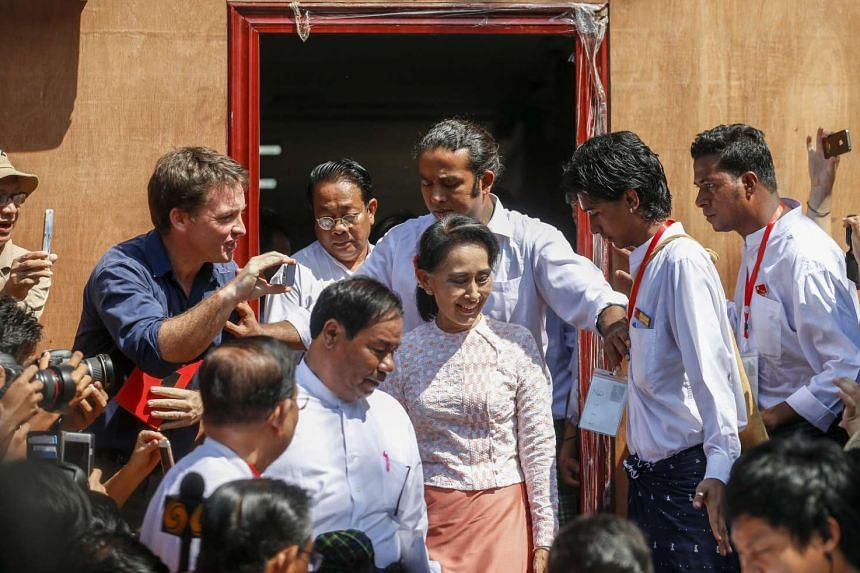 Myanmar's opposition leader Aung San Suu Kyi (centre), leaving the NLD headquarters after delivering a speech on Nov 9, 2015.