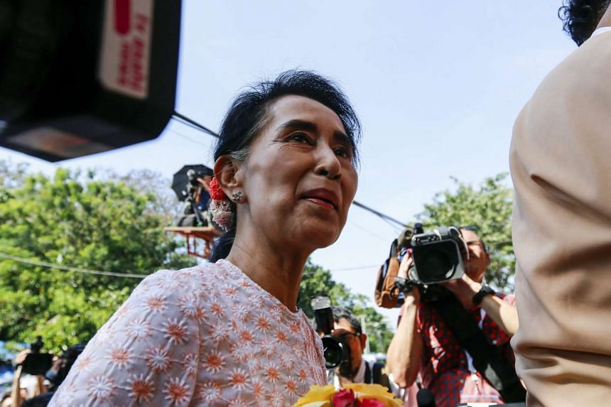 NLD leader Aung San Suu Kyi arriving at the headquarters to deliver a speech on Nov 9, 2015.