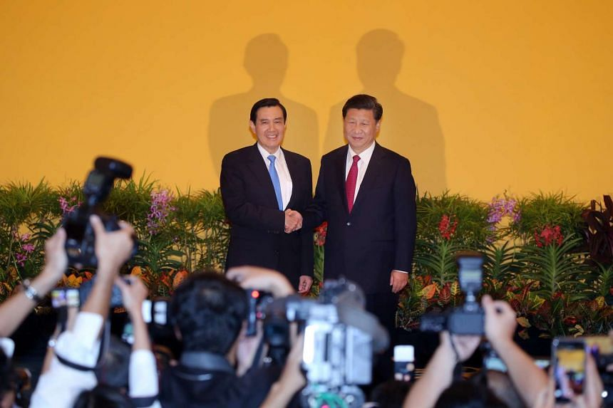 A historical moment as China President Xi Jinping (right) shakes the hands of Taiwanese President Ma Ying-jeou at Shangri-La Hotel on Nov 7, 2015.