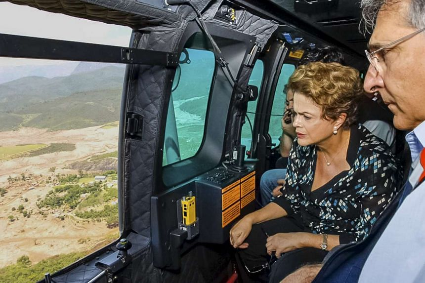 Brazilian President Dilma Rousseff (left) flies over the areas hit by the dam collapse.