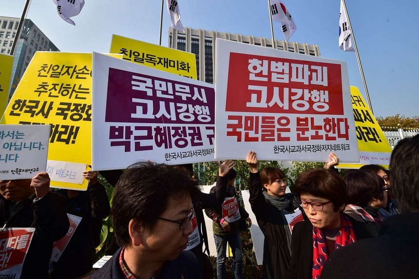 South Koreans protest against their government's policy to have students taught history only with government-issued textbooks on Nov 3, 2015.