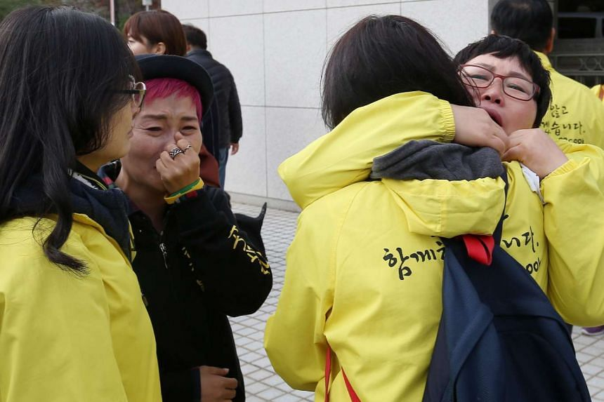 Family members of the victims of the sunken ferry Sewol outside the Supreme Court in Seoul on Nov 12, 2015, after the top court upheld the life sentence for the ferry's captain.