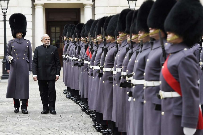 Indian Prime Minister Narendra Modi inspecting the guard of honour in London yesterday. Diplomats said deals worth up to £12 billion (S$26 billion) could be signed during Mr Modi's landmark visit.