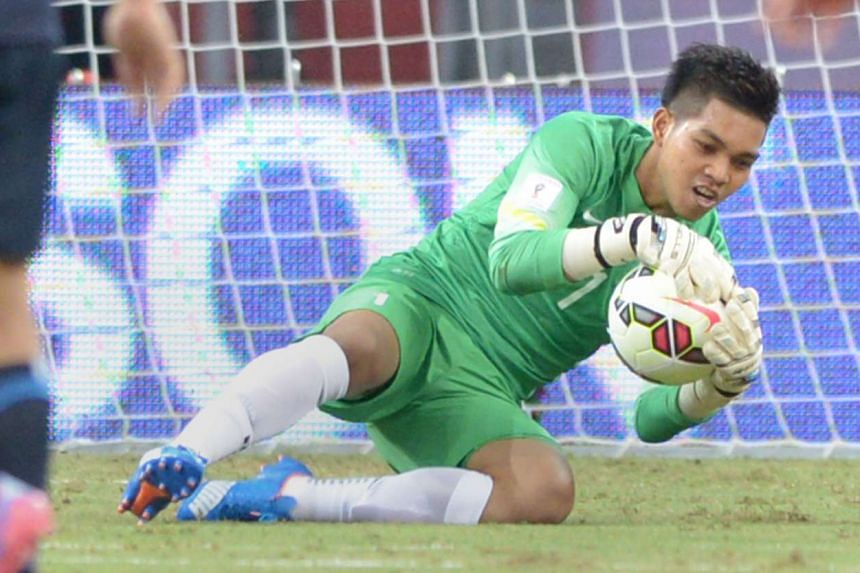 Izwan Mahbud saving a shot during the 0-3 loss to Japan. The Singapore goalkeeper was praised by both sides' coaches.