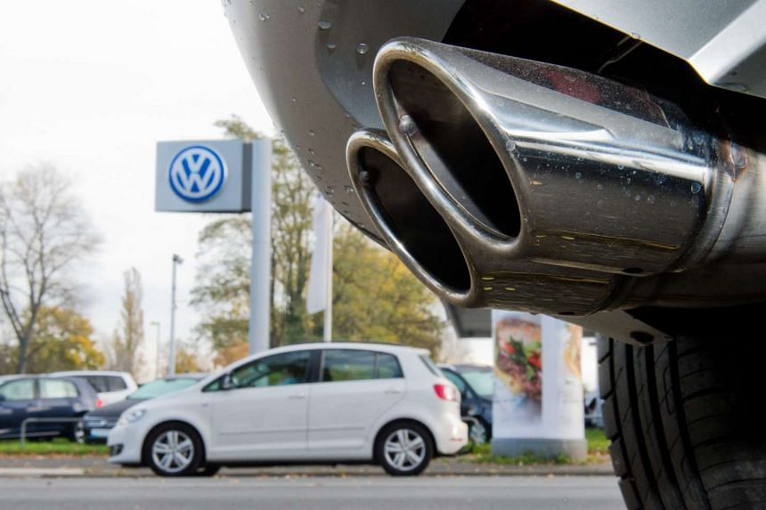 The exhaust pipe of a Skoda with a TDI diesel engine outside a Volkswagen used car dealership.