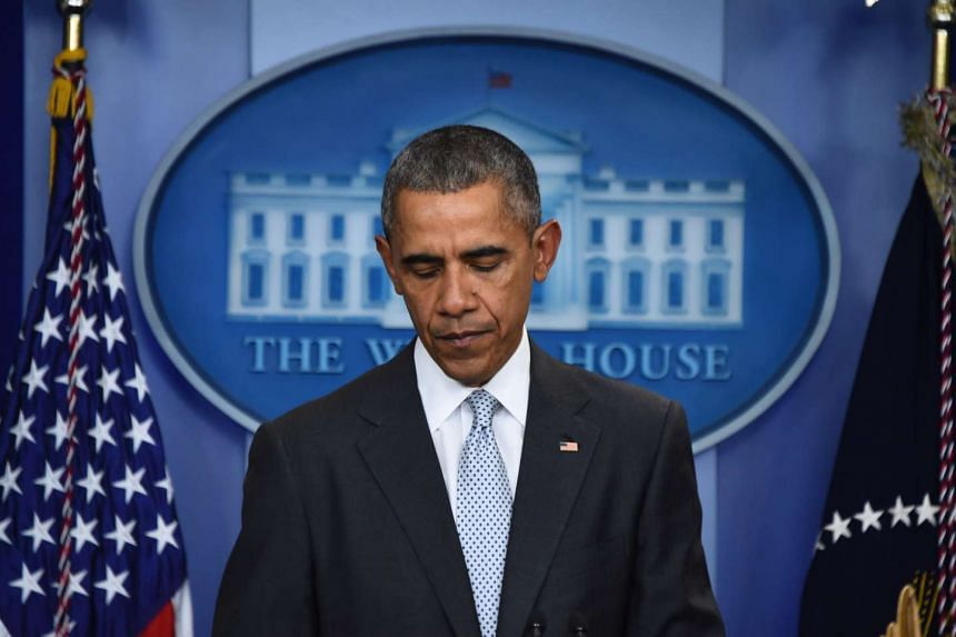 US President Barack Obama looking down as he speaks to the press in Washington, DC on Nov 13, 2015, after being informed about a series of deadly attacks that rocked Paris.