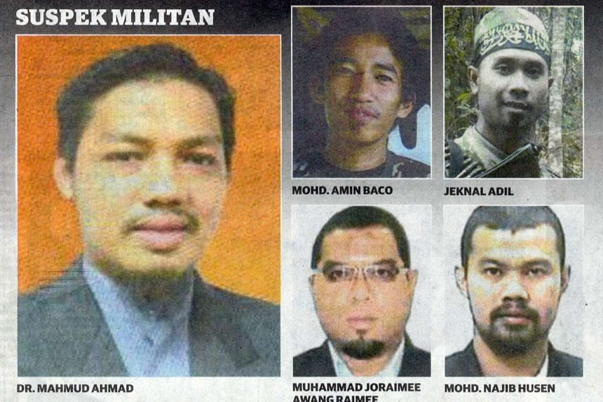 Combination photo of Dr Mahmud Ahmad (left), and four other individuals who are wanted for investigations into their alleged involvement in militant activities.