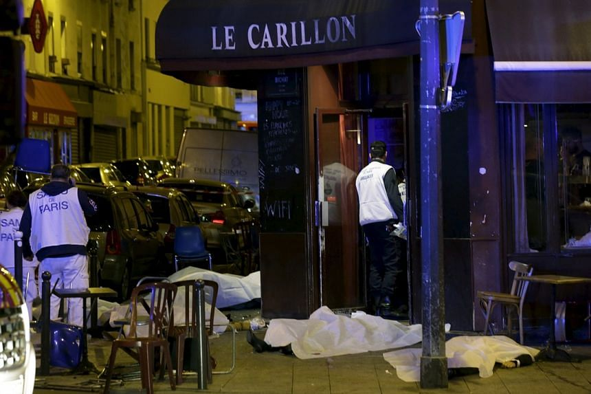 The covered bodies outside the restaurant following a shooting incident in Paris.
