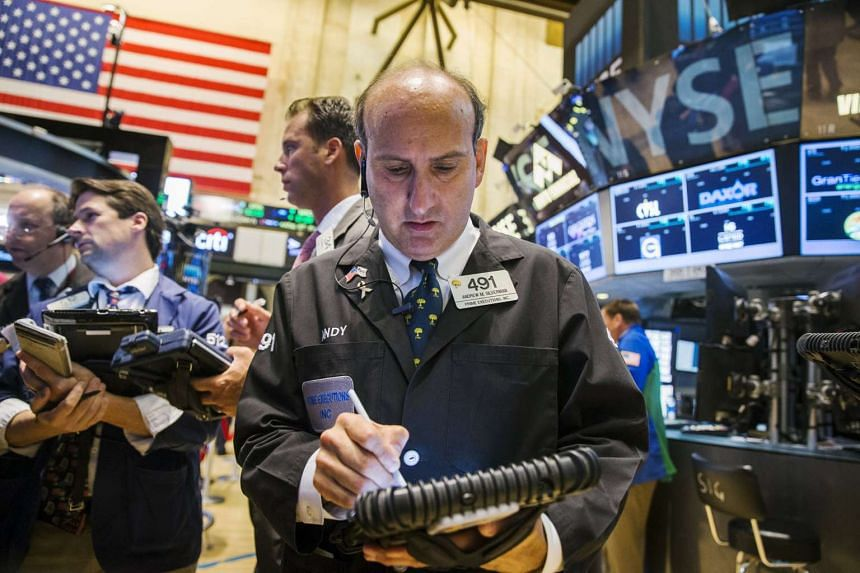 A trader works on the floor of the New York Stock Exchange shortly after the market opened in New York on Sept 1, 2015.