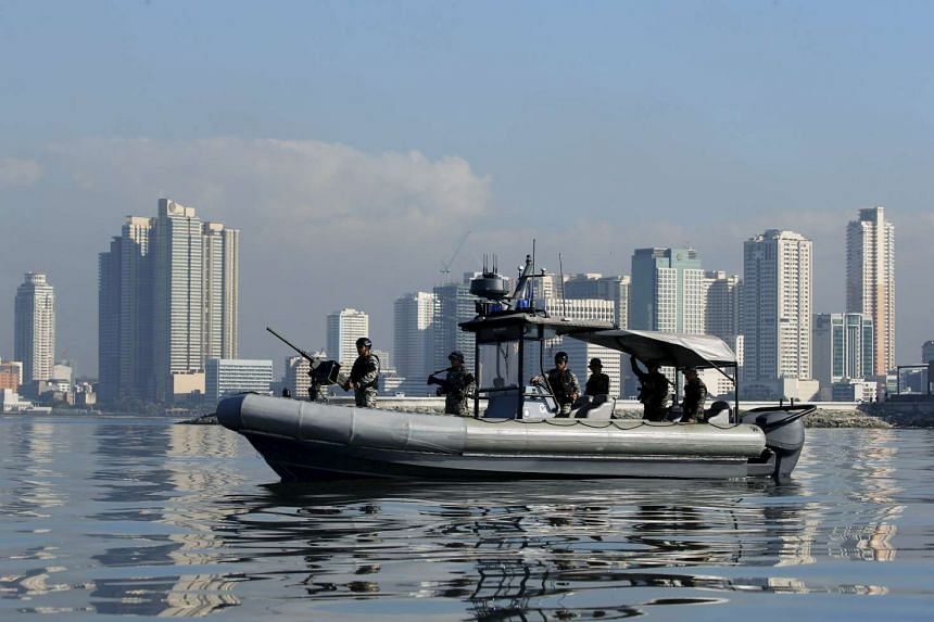 A Philippine Navy patrol boat taking position along the Manila bay, near the venues of the Asia-Pacific Economic Cooperation (APEC) summit, which will be held next week.
