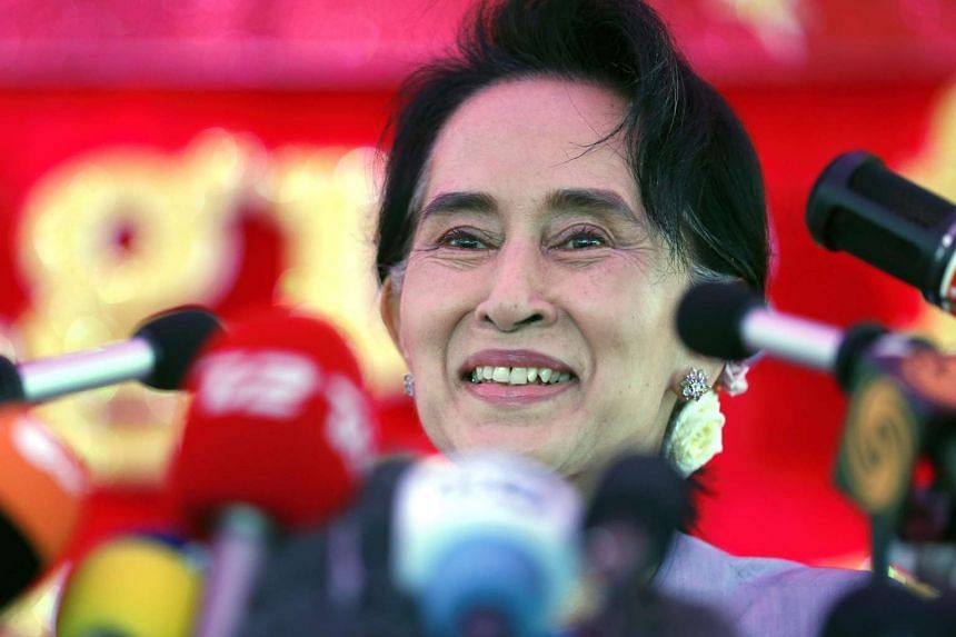 Myanmar's National League for Democracy Party leader Aung San Suu Kyi speaks to media about the upcoming general elections, during a news conference at her home in Yangon November 5, 2015.