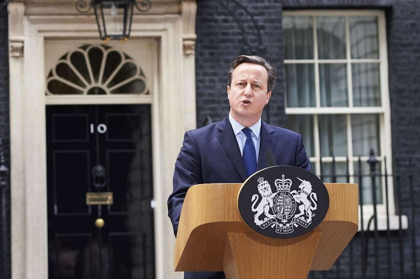 Prime Minister David Cameron said Britain would review security plans after attacks in Paris.
