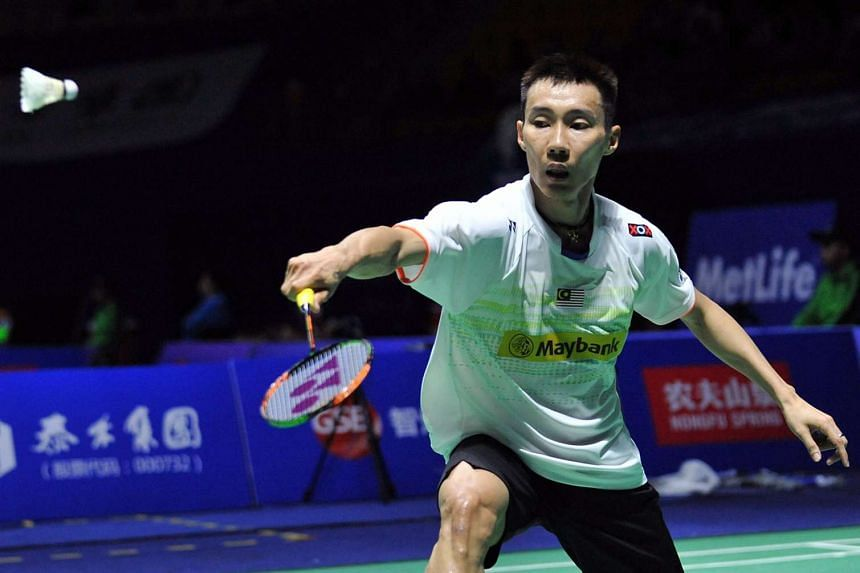 Lee Chong Wei of Malaysia hitting a return against Jan O Jorgensen of Denmark during their men's singles quarter-final match at the China Open badminton tournament on Nov 13, 2015.