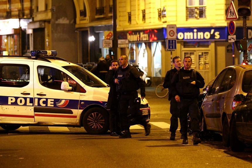 Police officers arriving at the scene of a shooting in Paris, France on Nov 13, 2015.