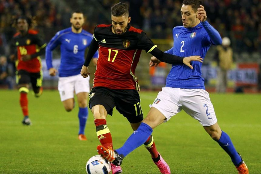 Belgium's Yannick Carrasco (left) in action against Italy's Mattia De Sciglio.