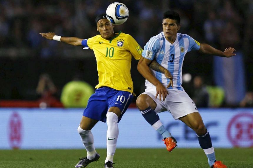 Brazil's Neymar (left) fighting for the ball with Lucas Biglia of Argentina during their 2018 World Cup qualifying match on Nov 13, 2015.