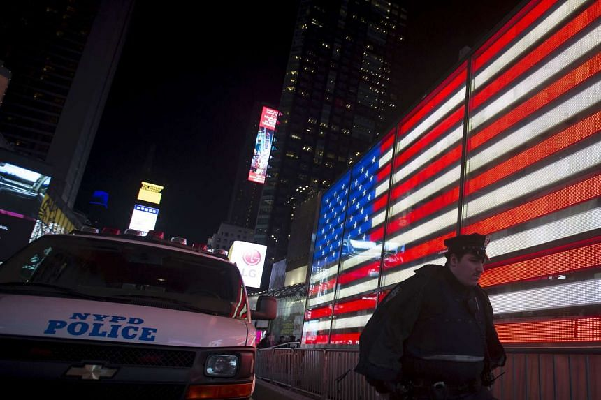 A New York police officer walking at  New York Times Square to bolster security after the attacks in Paris, on Nov 13, 2015.