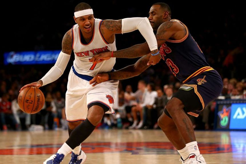 Carmelo Anthony (7) of the New York Knicks tries to get around LeBron James (23) of the Cleveland Cavaliers in the fourth quarter.