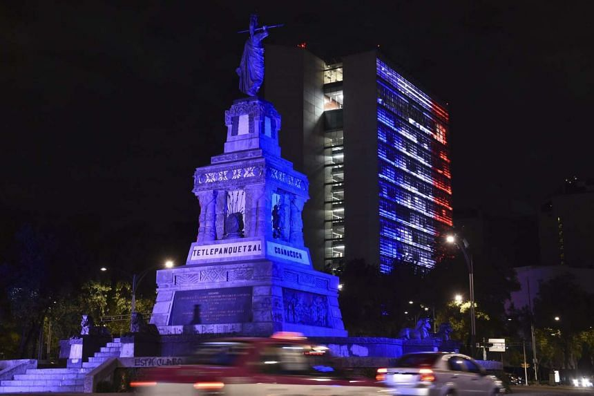 The Mexican Senate building is illuminated with red, white and blue colors of the French national flag.