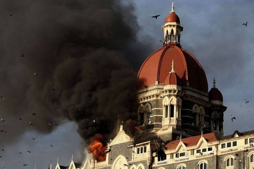 Flames and smoke gush out of The Taj Mahal Hotel, one of the sites of the 2008 Mumbai attacks by alleged militant gunmen.