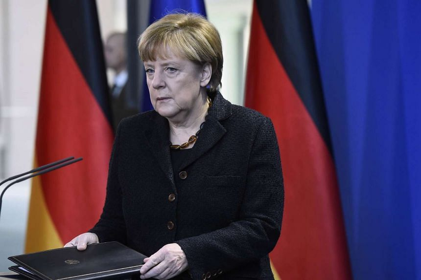German Chancellor Angela Merkel arrives to address the press at the Chancellery in Berlin.