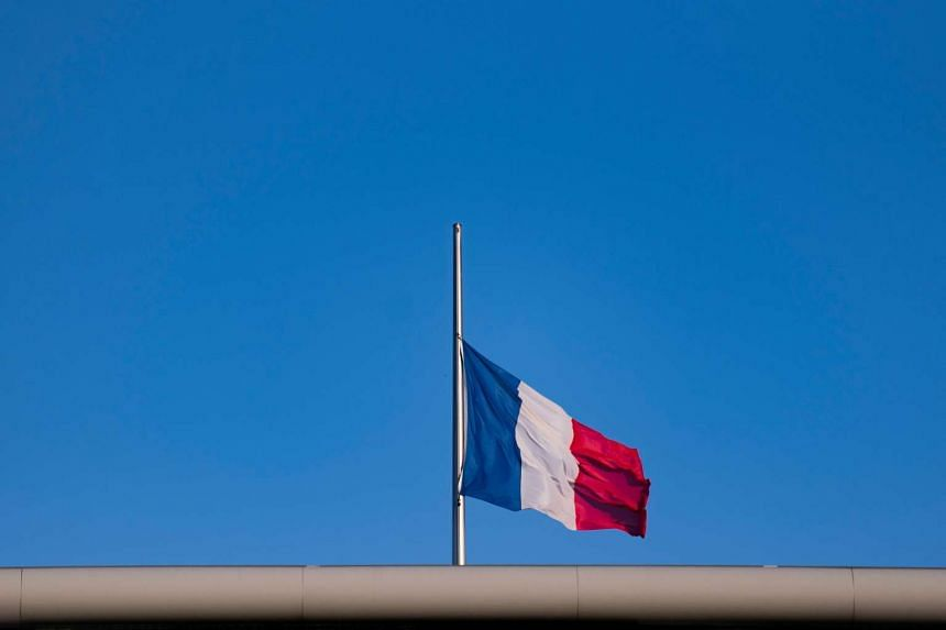 The French flag is seen at half mast at the embassy of France in Berlin Germany.