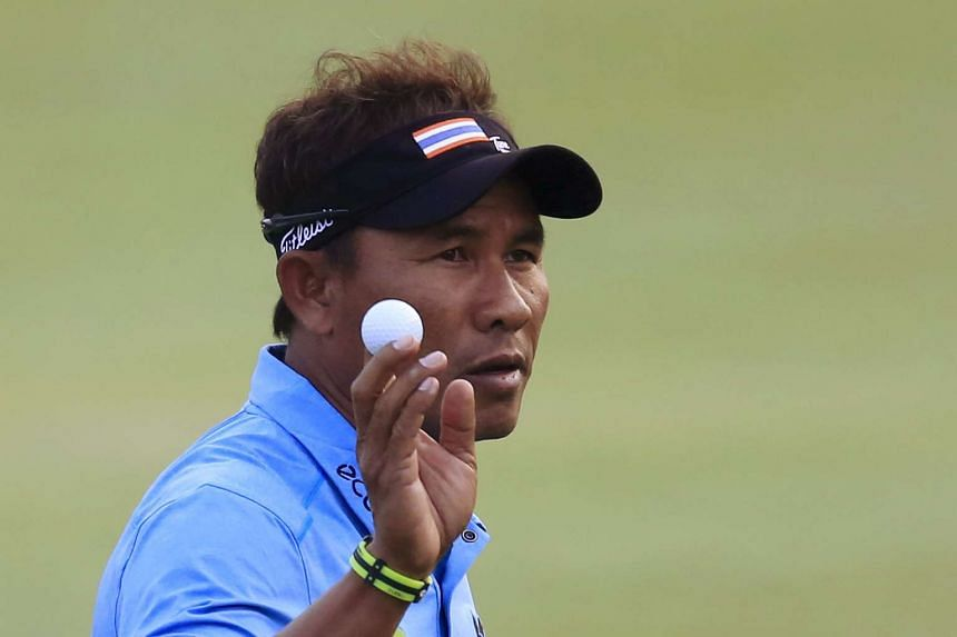 Thongchai Jaidee of Thailand gestures with the ball after a shot on the 18th hole.