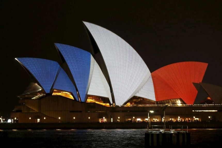 The blue, white and red colours of France's national flag are projected onto the sails of Sydney's Opera House in Australia.