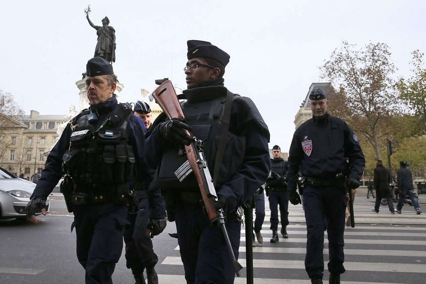 Police patrol in Place de la Republique the morning after a series of deadly attacks in Paris , Nov 14, 2015.