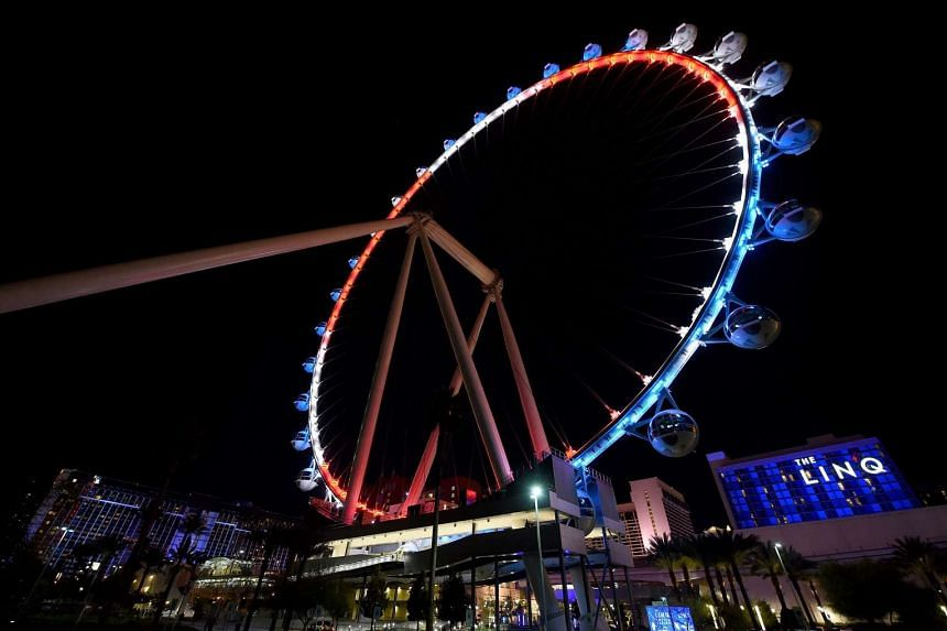 The High Roller at The LINQ Promenade on the Las Vegas Strip is lit up with the blue, white and red colors of the French flag.