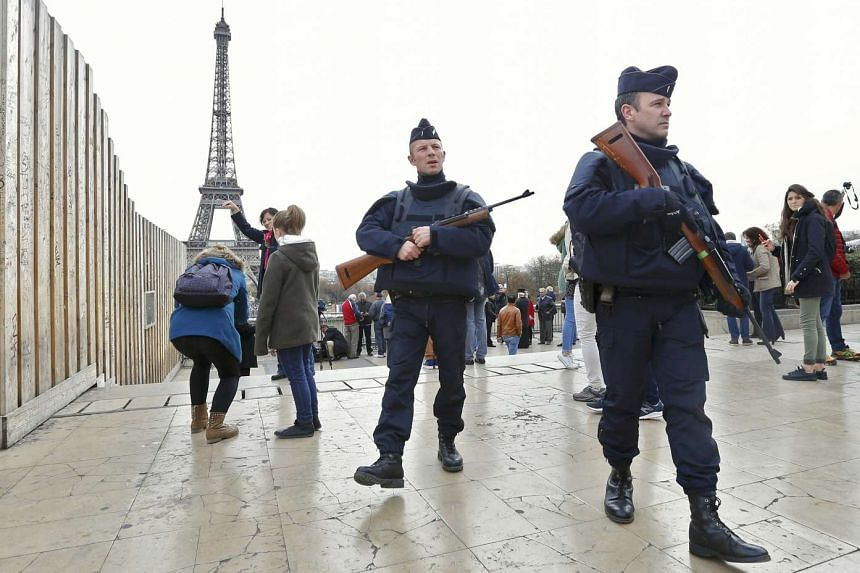 French police patrolling near the Eiffel Tower a day after the Paris attacks, on Nov 14, 2015.