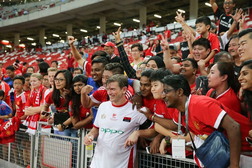 Former Manchester United player Jesper Blomqvist posing for a picture with fans after the match.