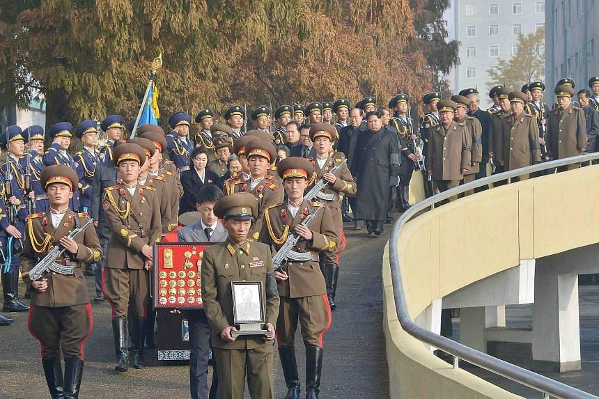 North Korean leader Kim Jong Un (right, in dark coat) at the state funeral of Korean People's Army marshal Ri Ul Sol in Pyongyang, in an undated photo released by North Korea's Korean Central News Agency on Thursday.