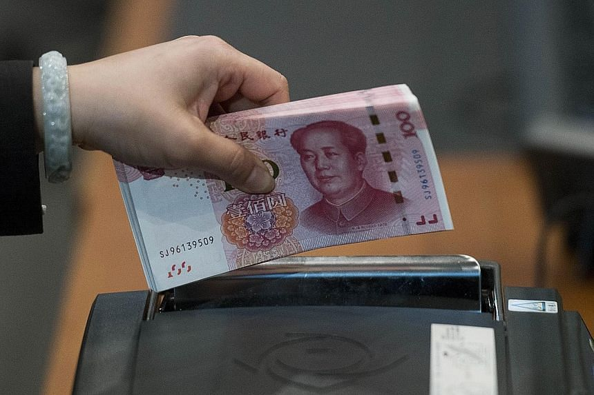 """China's new 100-yuan banknote, with anti-counterfeiting features, went into circulation on Thursday. The government has kept the denomination of Chinese legal tender low to """"curb both counterfeiting and corruption""""."""