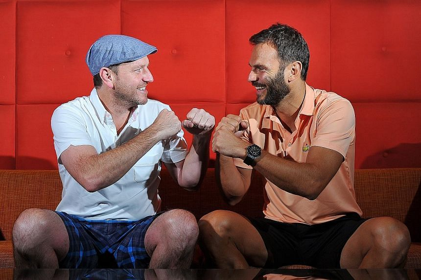 Former Manchester United winger Lee Sharpe (left) and former Liverpool midfielder Patrik Berger in a jolly mood before the duel. They will both be in the thick of the action in the Castlewood Group Battle of the Reds at the National Stadium this even