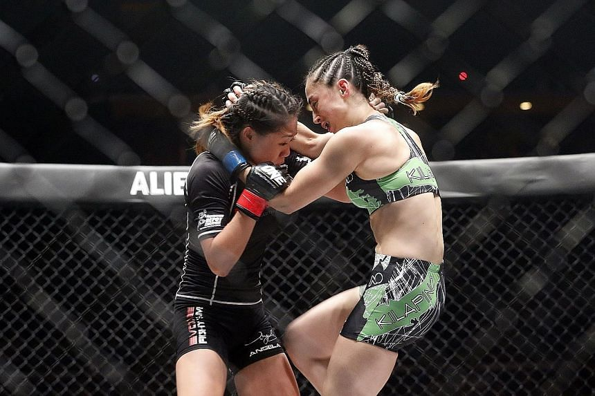 Born in Canada and raised in Hawaii, strawweight Angela Lee (in black) won her third straight fight by submission. She beat Australian Natalie Hills and then said the support she received from the crowd reminded her why it's so special to fight for S