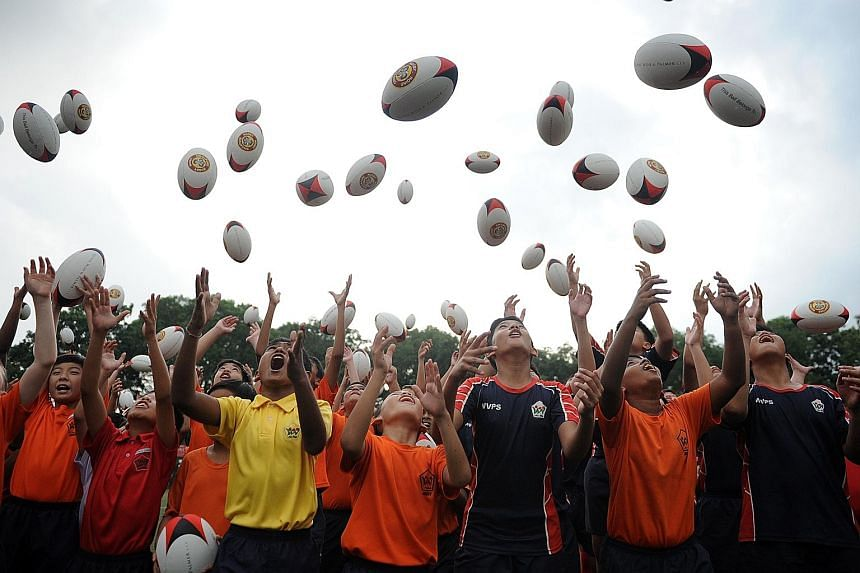 """The school-based """"Pass It On"""" programme reflects SRU president Low Teo Ping's desire that every young player should own a rugby ball."""
