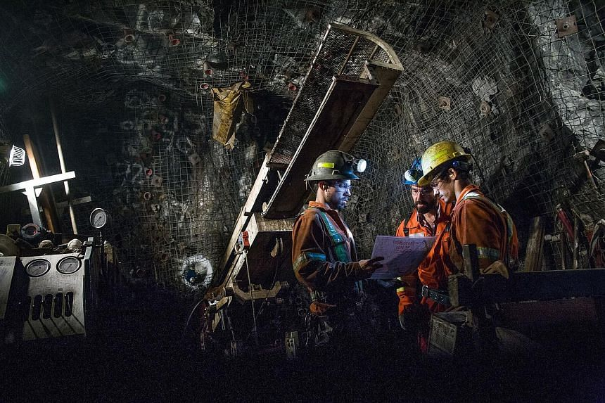 Contractors in a Glencore mine in Quebec, Canada. The debt-laden firm has faced wild fluctuations in its share price in recent months, with investors fearing that sinking commodity prices will affect its ability to meet outstanding debt obligations.